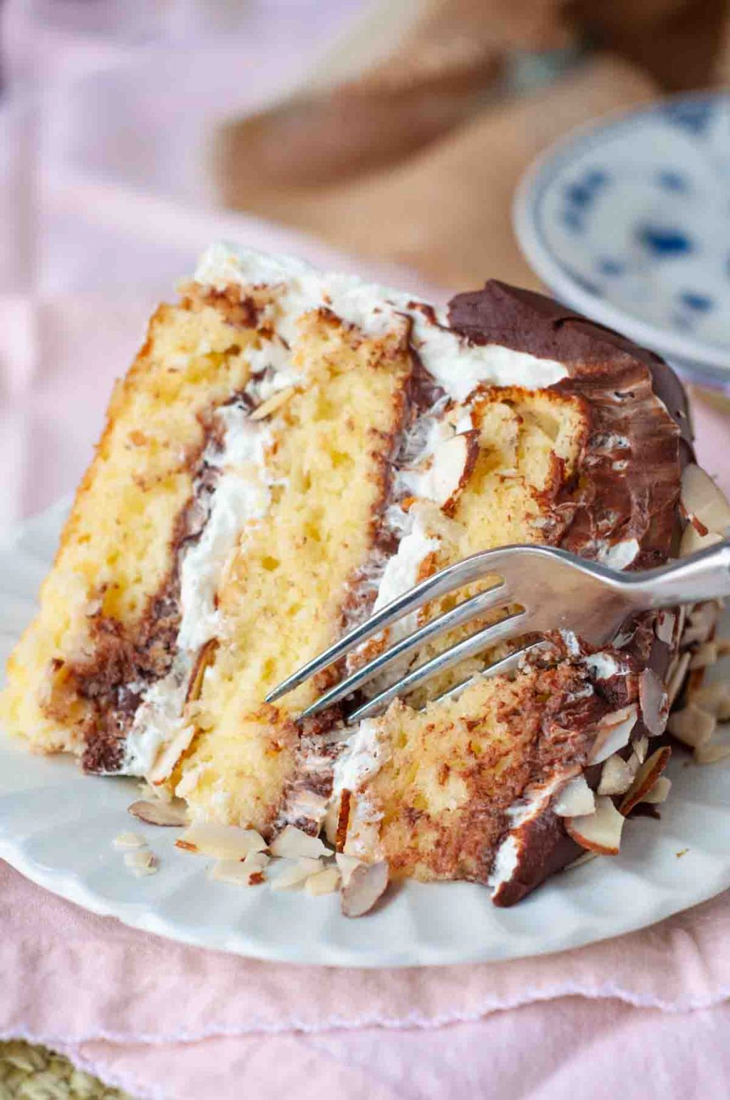 A slice of cake with a fork diving in