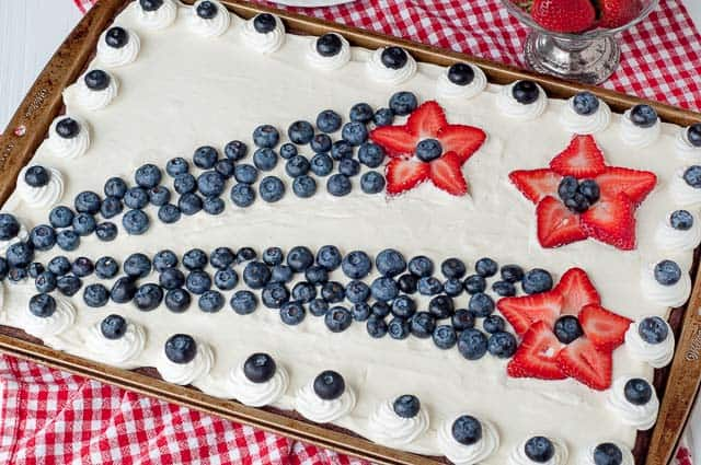 overhead shot of 4th of July brownies with strawberry shooting stars and blueberry tails trailing behind