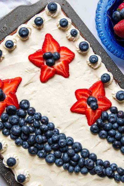 a pan of 4th of July brownies with strawberry stars and blueberry arches
