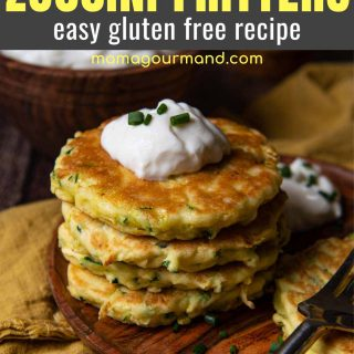 a stack of gluten-free zucchini pancakes with sour cream on top