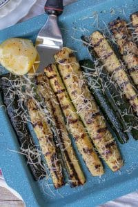 A closer up shot of a sheet pan with Best Grilled Zucchini and a spatula resting underneath