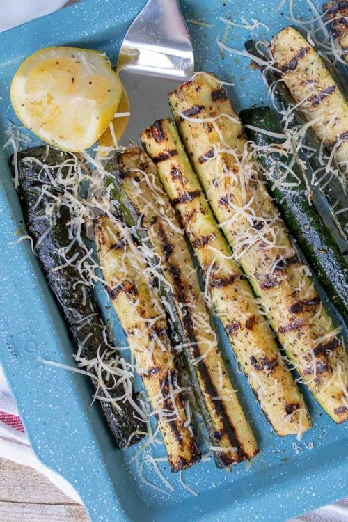 overhead shot of grilled zucchini with a squeezed lemon next to it