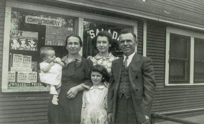 My mom (baby) with her sisters and parents in front of their store in Gary