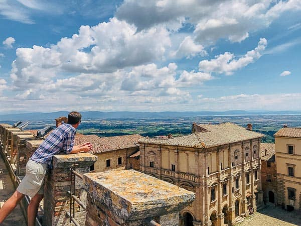 Ryan overlooking a plaza in Tuscany