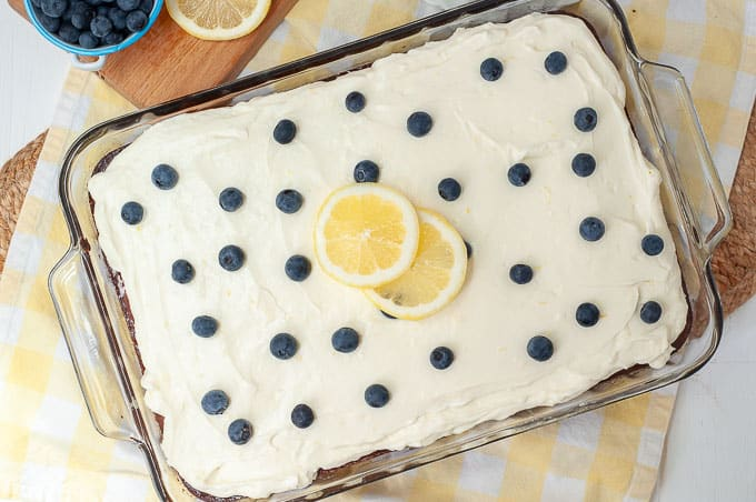 an overhead shot of lemon blueberry cake in a glass 9x13 pan