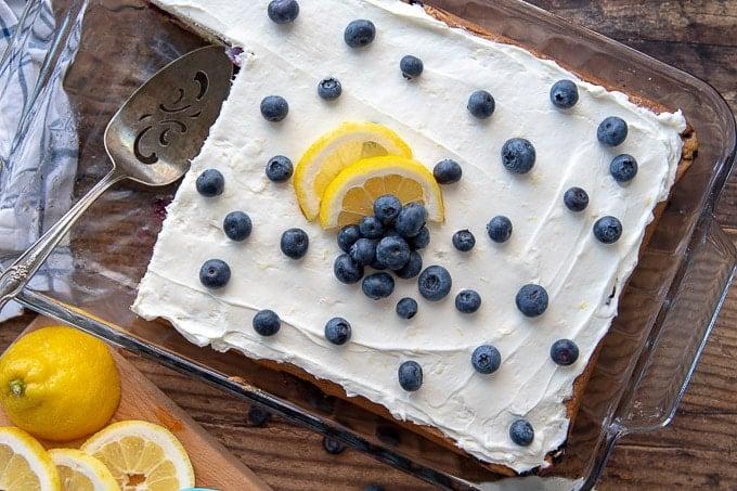an overhead shot of a whole lemon blueberry sheet cake