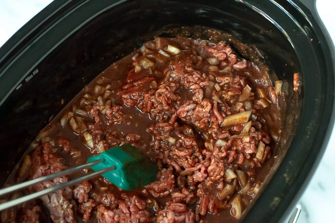 cincinnati chili being stirred in a crockpot