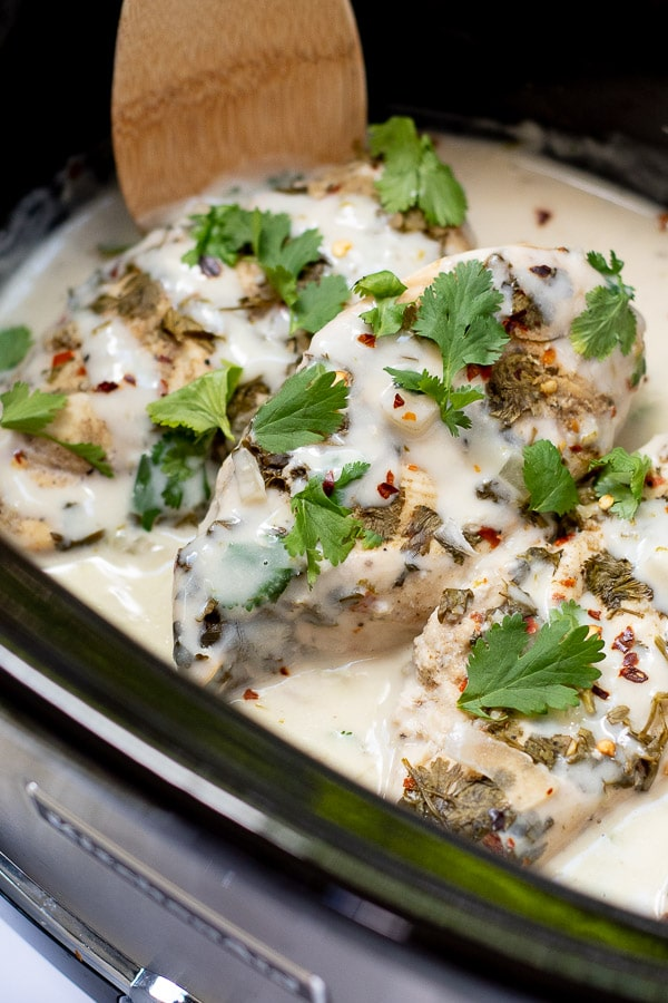 close up of cilantro chicken in a slow cooker