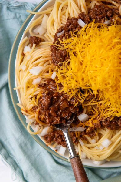 overhead shot of cincinnati chili with a fork going into spaghetti
