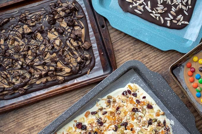 sheet pans with different types of chocolate bark