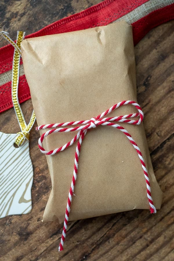 steps showing how to wrap chocolate bark like a candy bar