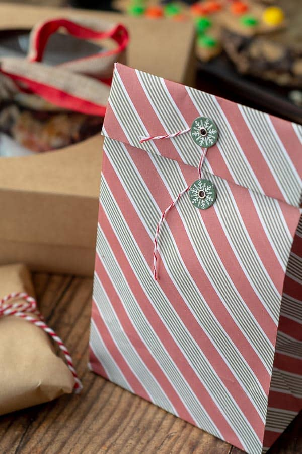 a candy gift bag filled with homemade chocolate bark