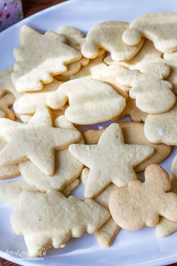a plate full of undecorated soft sugar cut out cookies