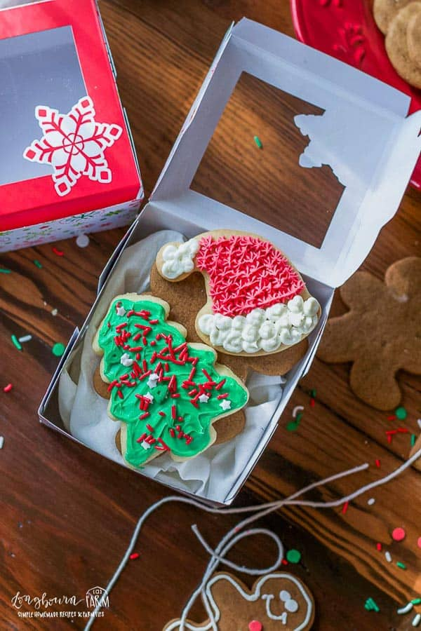 decorated cut out sugar cookies in a Christmas box