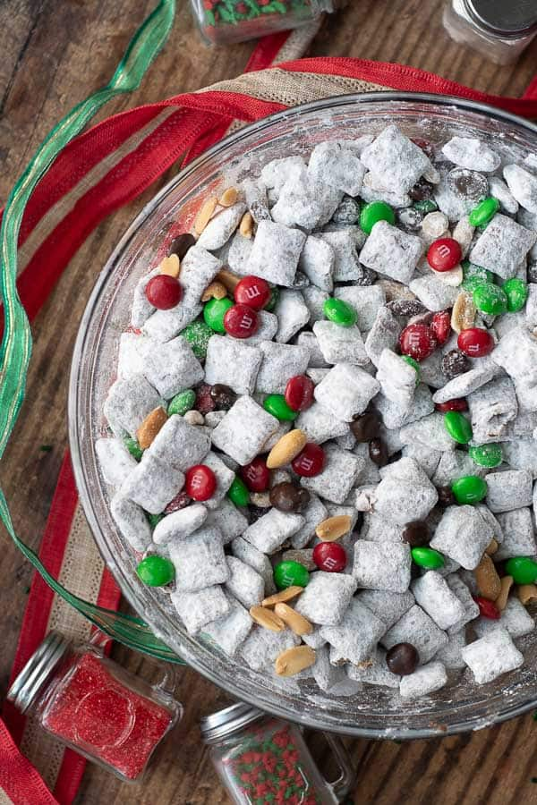 an overhead shot of Nutella puppy chow in a Christmas version with ribbon and sprinkles laying next to it