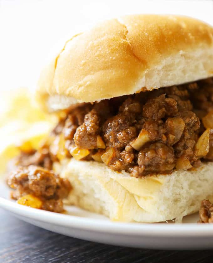 sloppy joes on a bun with potato chips for watching the game