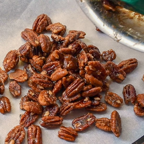 fourth step of how to make candied pecans - pour onto prepared baking sheet