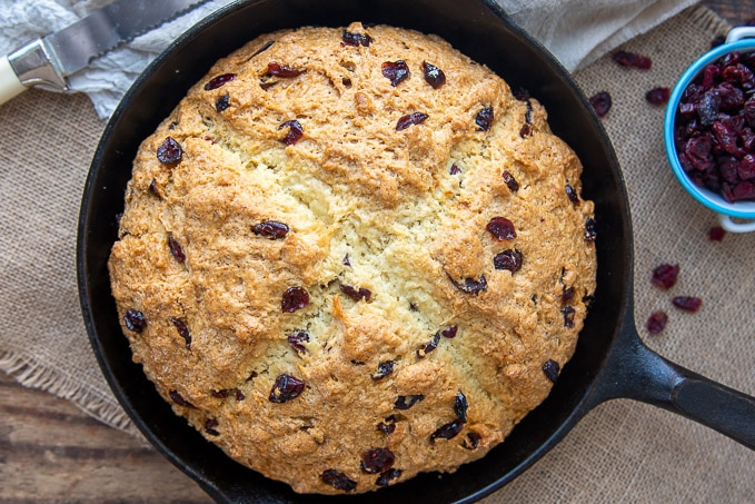 overhead shot of sweet irish soda bread in a cast iron skillet
