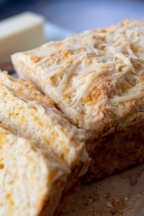 an up close shot of the top of quick cheese bread