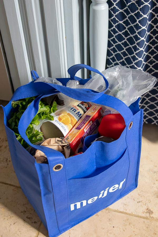 a bag of groceries in a meijer shopping bag