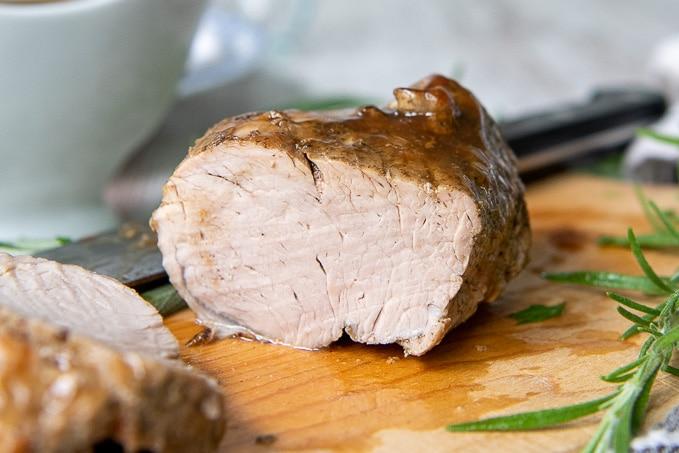 instant pot pork tenderloin on a wooden cutting board