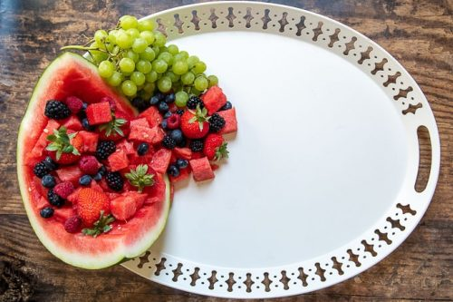 how to make a dessert platter second step - filling watermelon with fruit