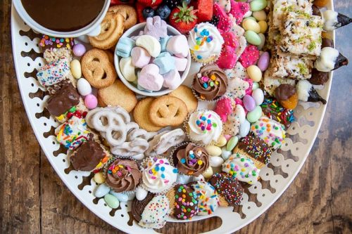 a close up on how the cookies and sweets are arranged on the dessert platter