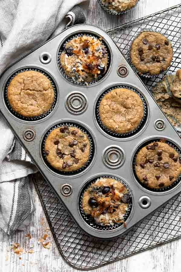 overhead shot of various types of almond flour muffins in a tin