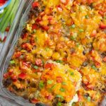 Sausage Breakfast Casserole in a glass dish with a spatula lifting out a piece