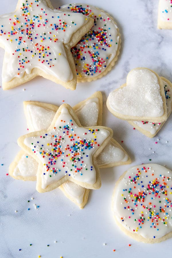 decorated sugar cookies with white frosting and sprinkles