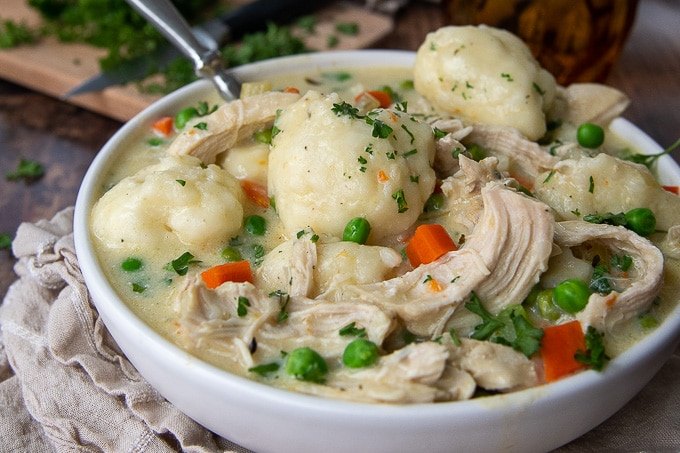 close up side angle of a bowl of chicken and dumplings