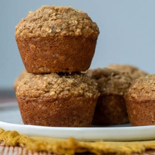 a stack of two applesauce muffins on a white plate