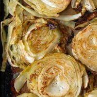 overhead shot of roasted cabbage on a baking sheet