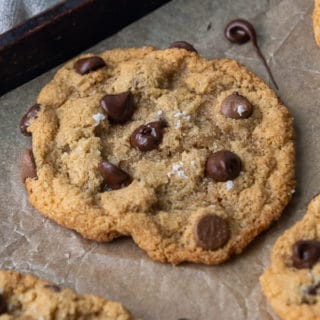 close up of almond flour chocolate chip cookie on a baking sheet