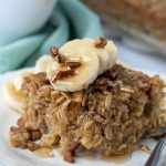 a slice of banana baked oatmeal with maple syrup dripping off