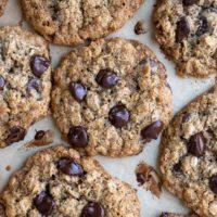 overhead shot of almond flour oatmeal cookies on a baking sheet