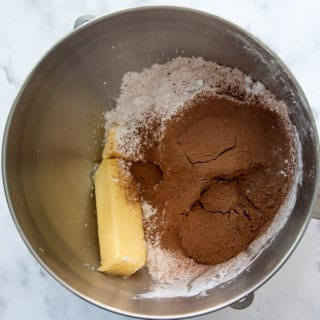ingredients in bowl to make fluffy chocolate buttercream
