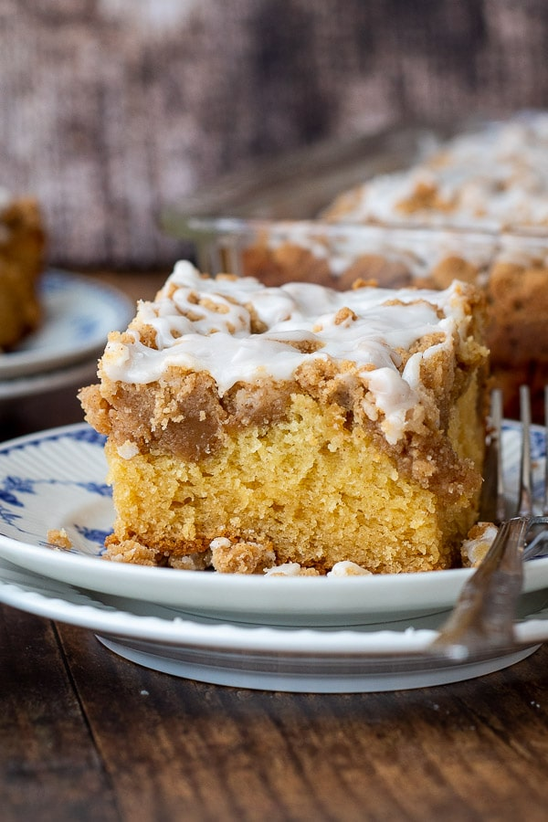 a slice of cinnamon gluten free coffee cake with a fork resting next to it