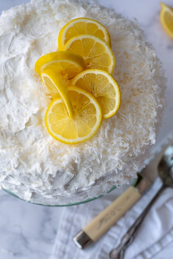 close up of top of lemon coconut layer cake