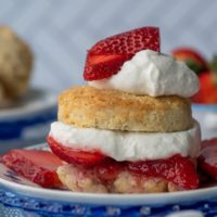 a gluten free strawberry shortcake layered with fresh strawberry sauce and whipped cream