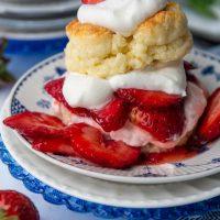 gluten free shortcake on top of fresh strawberries and whipped cream