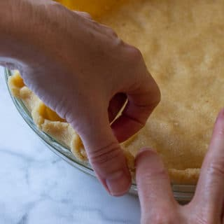 showing how to flute a pie crust edge