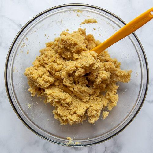 a bowl with almond flour pie dough inside