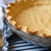 close up of baked almond flour crust in a glass dish