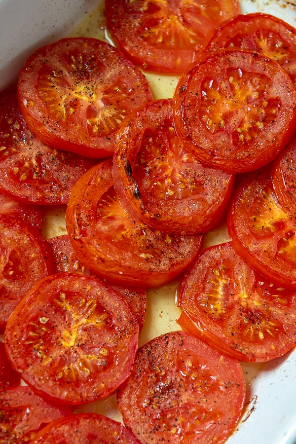 charred, oven roasted tomato slices with olive oil