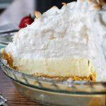 interior view of a whole frozen lemon meringue pie sliced open