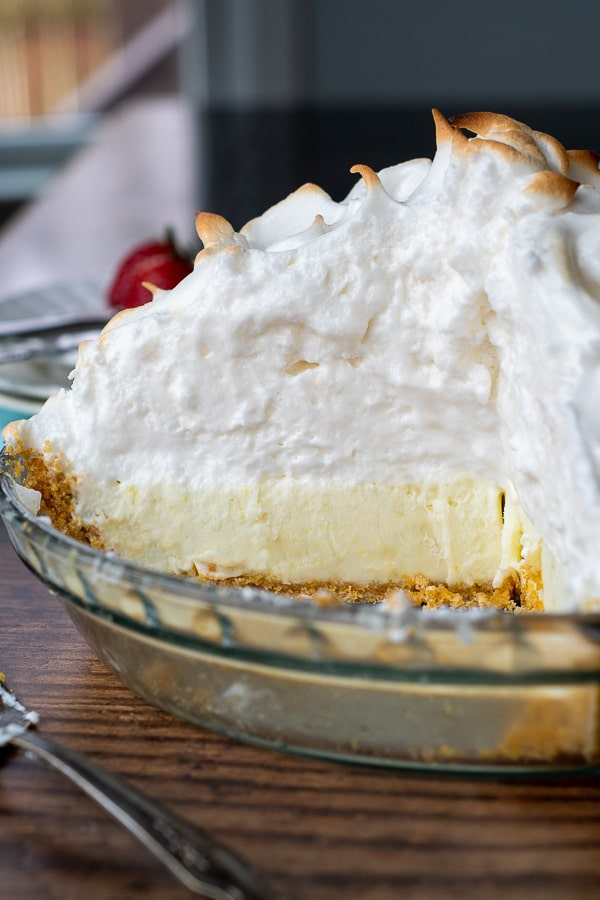 interior view of a whole frozen lemon meringue pie sliced open