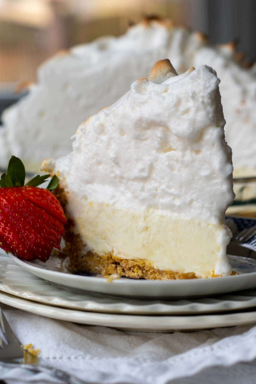 a slice of frozen pie on a plate with meringue topping