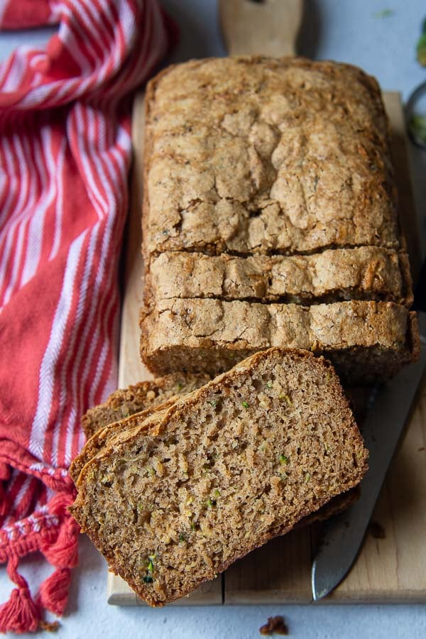 ovehead shot of sliced zucchini bread with a slice facing up towards the cameral