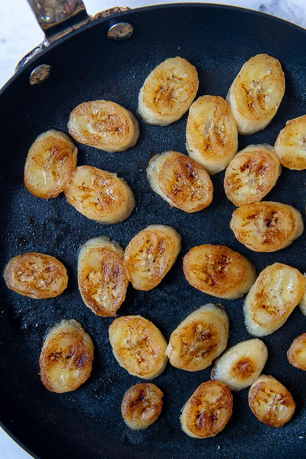 overhead shot of pan fried bananas in a saute pan
